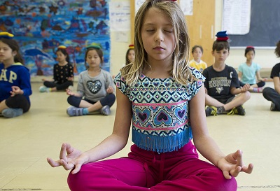 MACLEANS-MEDITATION-05.23.14-TORONTO, ON: Grade 3 students at the Dewson Street Junior Public School attend a meditation class called